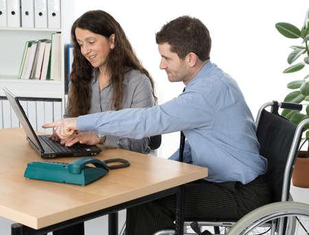wheelchair user in the office Standard-Bild