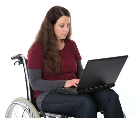 woman in wheelchair working with the computer