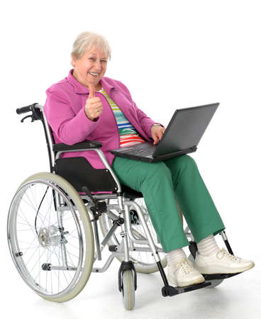 female senior in wheelchair using a computer 版權商用圖片 - 34758879