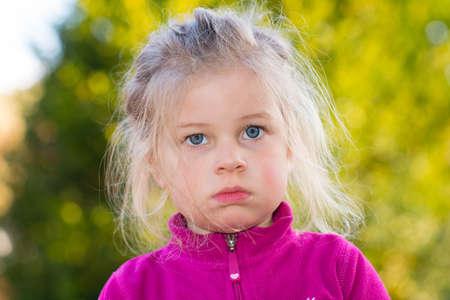 skeptical: girl looking skeptical Stock Photo
