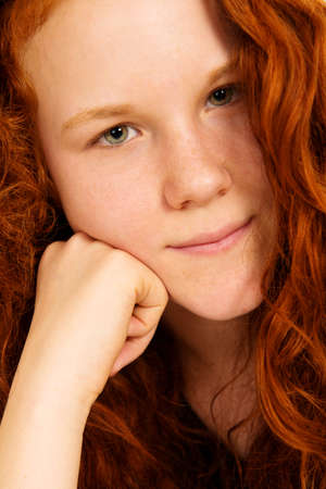 shrewd: red-haired girl Stock Photo