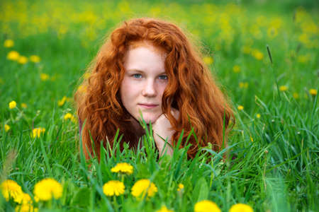 girl in the spring meadow photo