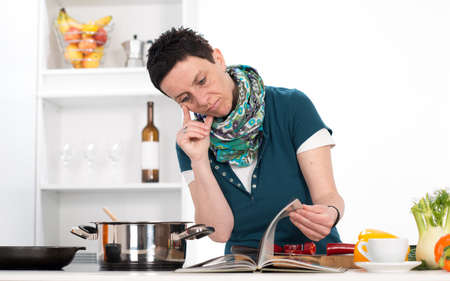 woman looking at cooking recipe photo