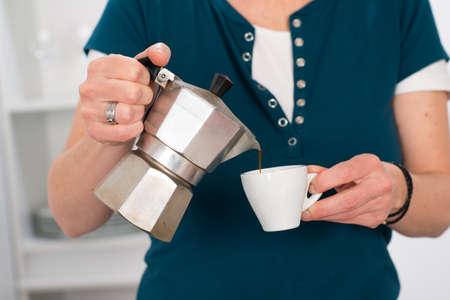 woman pouring espresso  photo