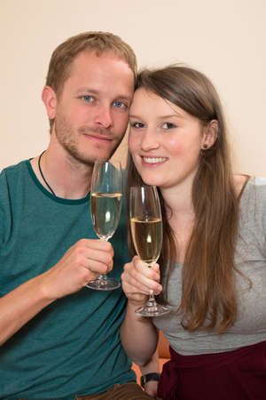 twosome: young man and woman drinking sparkling wine Stock Photo