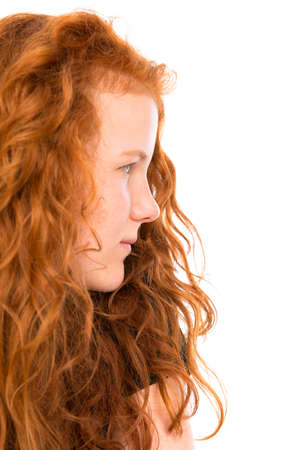 red haired: red haired girl in profile Stock Photo