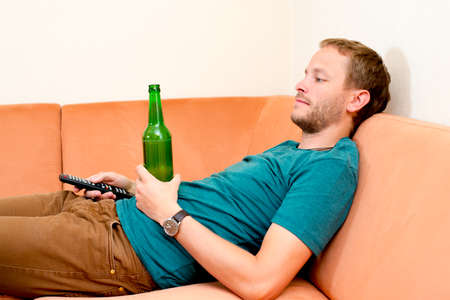 closing time: young man is relaxing at home