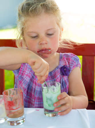 bonny: child is eating dessert