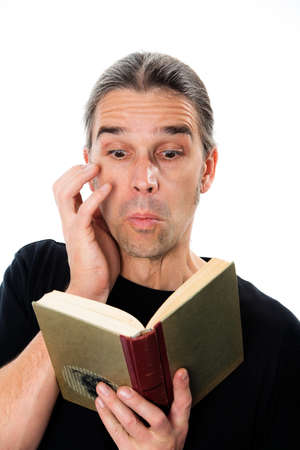 angst: man is reading a enthralling book Stock Photo