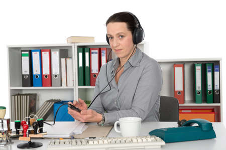 businesswoman listening music in office photo