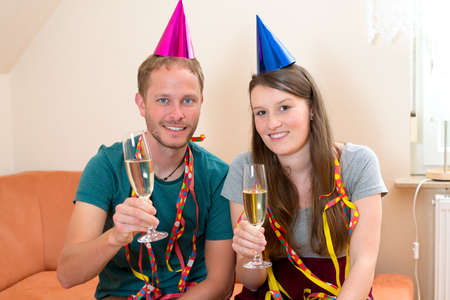 out of engagement: young man and woman have a party Stock Photo