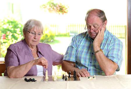 senior couple playing chess photo