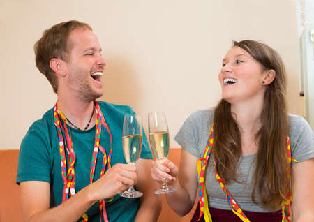 out of engagement: young man and woman making a party