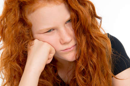 huffy: red haired girl in bad temper Stock Photo