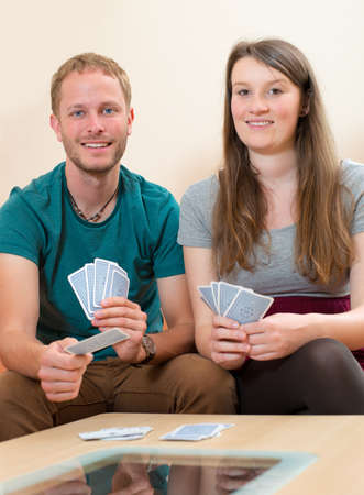 card game: young man and woman playing card game