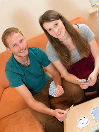 twosome: young man and woman playing card game