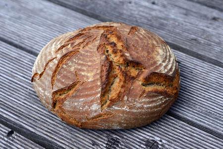 round bread on wooden ground