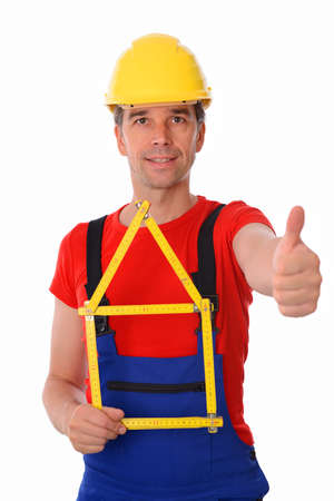 yardstick: worker with folding yardstick- house and thumb up