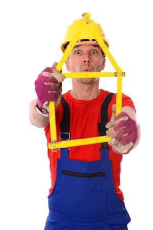 yardstick: funny worker with folding yardstick- house