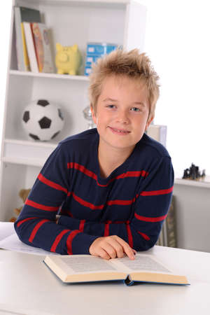 outwork: reading boy is smiling Stock Photo