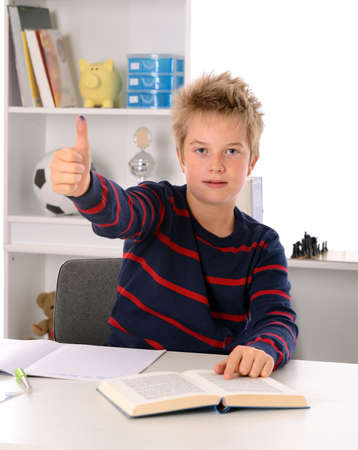 outwork: learning boy with thumb up