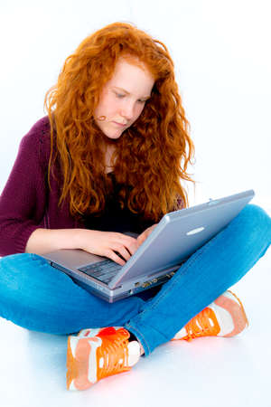 red haired: red haired girl is using tablet pc