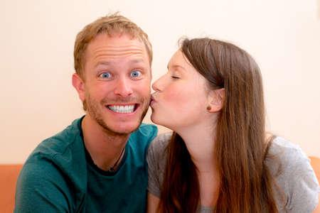 young man and woman kissing 版權商用圖片
