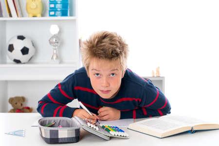 outwork: boy is doing homework