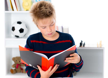 boy is reading a book