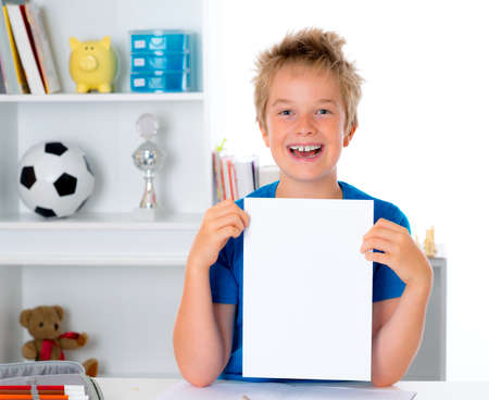 chit: happy boy showing a white chit