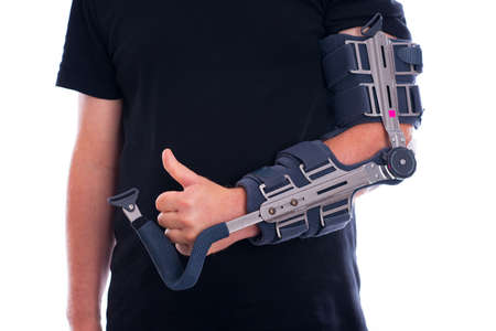 broken arm with thumb up Stock Photo