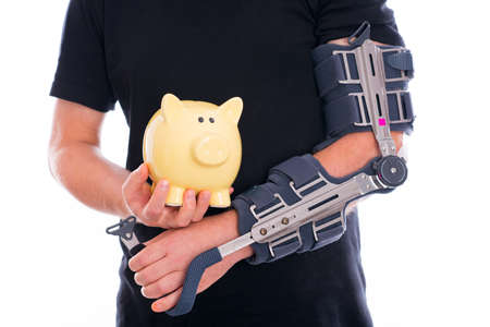 man with broken arm and piggy bank photo
