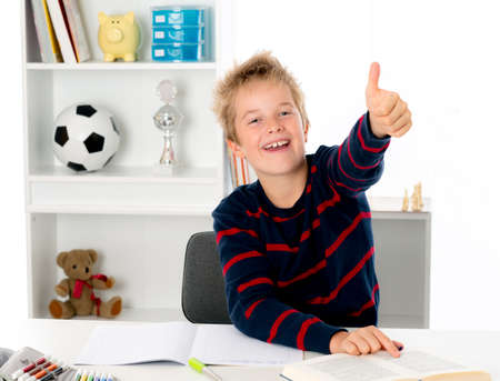 happy learning boy with thumb up Stock Photo