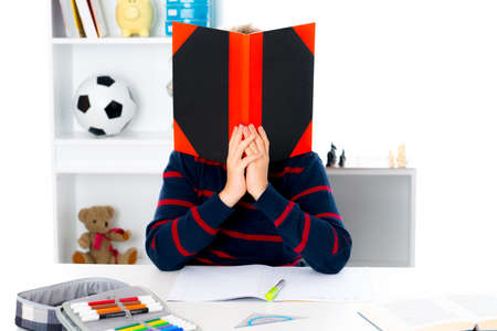 illiteracy: boy has a problem with reading
