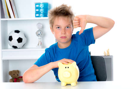 bad planning: boy with piggy-bank and thumb down