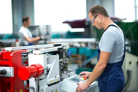 worker on the machine