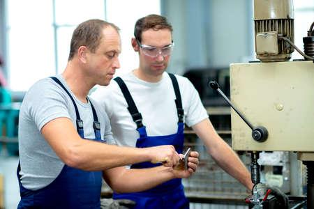 two worker on the machine 版權商用圖片