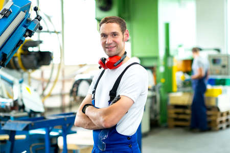 friendly worker in factory Stock Photo
