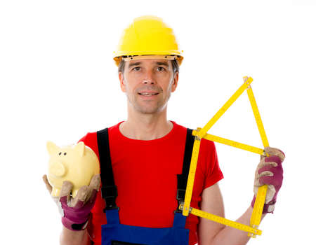 yardstick: worker with yardstick- house and piggy bank Stock Photo