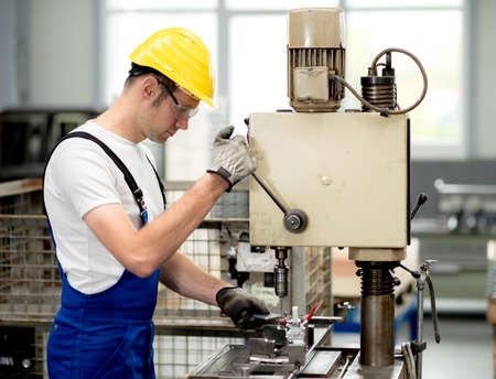 worker on drill machine