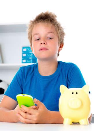 piggybank: boy with piggy-bank and phone Stock Photo
