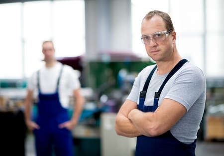 jobholder: young worker in factory Stock Photo
