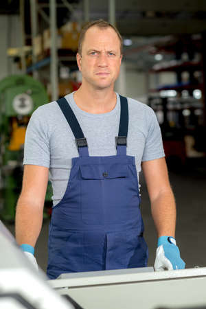 young worker in factory Stock Photo