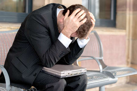 over worked: businessman has to much of work Stock Photo