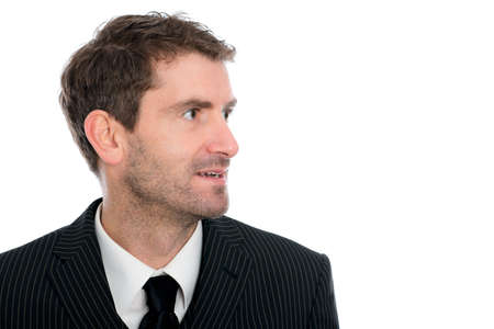businessman in front of white background looking sideward