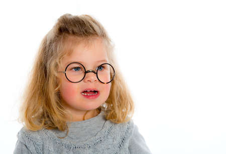 bonny: little girl with round glasses Stock Photo