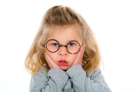 dullness: little girl with round glasses is bored