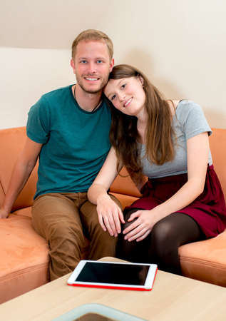 twosome: young man and woman at home in the living room