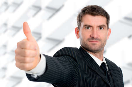 businessman in front of white background with thumb up photo