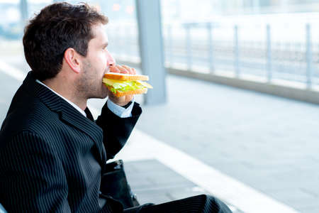 businessman on trip has a breakand eating photo